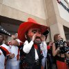 Pistol Pete cheers during the Spirit Walk before the Valero Alamo Bowl college football game between the Oklahoma State University Cowboys (OSU) and the University of Arizona Wildcats at the Alamodome in San Antonio, Texas, Wednesday, December 29, 2010. Photo by Sarah Phipps, The Oklahoman