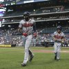 Photo - Atlanta Braves' Jason Heyward, left, walks towards the dugout after hitting a solo home run in the first inning of a baseball game against the New York Mets, Wednesday, Aug. 27, 2014, in New York. (AP Photo/John Minchillo)