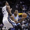 Denver Nuggets\' Andre Iguodala, right, is guarded by Memphis Grizzlies\' Rudy Gay (22) during the first half of an NBA basketball game in Memphis, Tenn., Monday, Nov. 19, 2012. (AP Photo/Danny Johnston)