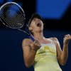 Russia\'s Maria Sharapova celebrates after defeating Venus Williams of the US in their third round match at the Australian Open tennis championship in Melbourne, Australia, Friday, Jan. 18, 2013. (AP Photo/Dita Alangkara)