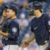 Seattle Mariners starting pitcher Erasmo Ramirez, left, wipes his forehead after talking with catcher Mike Zunino, right, in the second inning of a baseball game against the Kansas City Royals at Kauffman Stadium in Kansas City, Mo., Tuesday, Sept. 3, 2013. (AP Photo/Orlin Wagner)