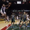 Orlando Magic\'s Arron Afflalo goes up for a shot during the first half of an NBA basketball game against the Milwaukee Bucks Sunday March 17, 2013, in Milwaukee. (AP Photo/Morry Gash)