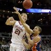 OU\'s Blake Grifin passes the ball over Morgan State\'s Kevin Thompson during a first round game of the men\'s NCAA tournament between Oklahoma and Morgan State in Kansas City, Mo., Thursday, March 19, 2009. PHOTO BY BRYAN TERRY, THE OKLAHOMAN