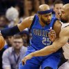 Dallas\' Vince Carter (25) works against Oklahoma City\'s Derek Fisher (6) during an NBA basketball game between the Oklahoma City Thunder and the Dallas Mavericks at Chesapeake Energy Arena in Oklahoma City, Sunday, March 16, 2014. Photo by Nate Billings, The Oklahoman