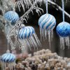A thick coat of ice surrounds Christmas ornaments in trees on Saturday, Dec. 21, 2013 in Norman, Okla. Photo by Steve Sisney, The Oklahoman