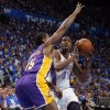 Oklahoma City\'s Kevin Durant (35) looks to shoots as Los Angeles\' Metta World Peace (15) defends during Game 1 in the second round of the NBA playoffs between the Oklahoma City Thunder and the L.A. Lakers at Chesapeake Energy Arena in Oklahoma City, Monday, May 14, 2012. Photo by Sarah Phipps, The Oklahoman
