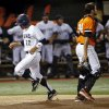UC Irvine\'s Chris Rabago (22) scores past OSU\'s Bryan Case (34) in the bottom of the first inning during Game 2 of the NCAA baseball Stillwater Super Regional between Oklahoma State and UC Irvine at Allie P. Reynolds Stadium in Stillwater, Okla., Saturday, June 7, 2014. Photo by Nate Billings, The Oklahoman