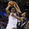 Oklahoma City\'s Kevin Durant (35) is fouled by Sacramento\'s Rudy Gay (8) during an NBA game between the Oklahoma City Thunder and the Sacramento Kings at Chesapeake Energy Arena in Oklahoma City, Friday, March 28, 2014. Photo by Bryan Terry, The Oklahoman