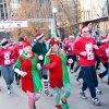 Participants run, jog and walk during the SandRidge Santa Run, part of Downtown in December. Photo provided.