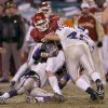 Kansas City, MO. USA. Saturday, December 6, 2003: Big 12 Championship College Football Arrowhead Stadium, University of Oklahoma vs Kansas State University (KSU): OU\'s Lance Donley is tackled by Ted Sims. Staff photo by Steve Sisney.