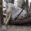 FILE - In this Monday, Oct. 20, 2008 file photo, a boulder sits atop debris after it fell in Curry Village in Yosemite National Park, Calif. Falling boulders are the single biggest force shaping Yosemite Valley, one of the most popular tourist destinations in the national park system. Now swaths of some popular haunts are closing for good after geologists confirmed that unsuspecting tourists and employees are being lodged in harm\'s way. On Thursday, June 13, 2012, the National Park Service will announce that potential danger from the unstable 3,000-foot-tall Glacier Point, a granite promontory that for decades has provided a dramatic backdrop to park events, will leave some of the valley\'s most popular lodging areas permanently uninhabitable. (AP Photo/Paul Sakuma, File)