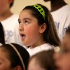 Mirey Sanchez, a fourth-grader, glances toward the Capitol dome as she joins other members of the Fourth and Fifth Grade Honor Choir from Linwood Elementary School during a performance prior to the Oklahoma A+ Schools Celebration at the Oklahoma state Capitol in in Oklahoma City on Wednesday, May 13, 2009. Photo by John Clanton, The Oklahoman