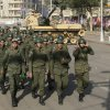 Soldiers walk past a military tank guarding the presidential palace in Cairo, Egypt, Thursday, Dec. 13, 2012. Egypt\'s opposition called on its followers to vote