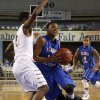 Millwood\'s Chris Cook drives past Malik Foxx during the 3A boys semifinal game between the Millwood High School Falcons and the Centennial Bison at the State Fair Arena on Friday, March 8, 2013 in Oklahoma City, Okla. Photo by Steve Sisney, The Oklahoman