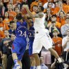 Oklahoma State \'s Michael Cobbins (20) pulls in a rebound over Kansas\' Travis Releford (24) during the college basketball game between the Oklahoma State University Cowboys (OSU) and the University of Kanas Jayhawks (KU) at Gallagher-Iba Arena on Wednesday, Feb. 20, 2013, in Stillwater, Okla. Photo by Chris Landsberger, The Oklahoman