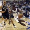 Photo - Dallas Mavericks guard Darren Collison (4) drives against San Antonio Spurs guard Tony Parker (9), of France, during the first half of an NBA basketball game in Dallas on Sunday, Dec. 30, 2012. (AP Photo/Mike Fuentes)
