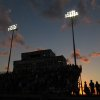 The sun sets as the National Anthem is played during the high school football game between Guthrie at Carl Albert in Midwest City, Friday, October 11, 2013. Photo by Doug Hoke, The Oklahoman
