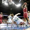 OU\'s Abi Olajuwon knocks down Notre Dame\'s Erica Williamson as she shoots the ball during the Sweet 16 round of the NCAA women\'s basketball tournament in Kansas City, Mo., on Sunday, March 28, 2010. Photo by Bryan Terry, The Oklahoman