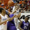 Oklahoma State\'s Toni Young (15) goes for the ball beside TCU\'s Latricia Lovings (21) during a women\'s college basketball game between Oklahoma State University and TCU at Gallagher-Iba Arena in Stillwater, Okla., Tuesday, Feb. 5, 2013. Oklahoma State won 76-59. Photo by Bryan Terry, The Oklahoman
