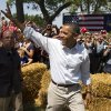 President Barack Obama waves during a campaign event at the Nelson Pioneer Farm & Museum, Tuesday, Aug. 14, 2012, in Oskaloosa, Iowa, during a three day campaign bus tour through Iowa. (AP Photo/Carolyn Kaster)