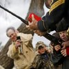 CHILD / CHILDREN / KIDS: Harley Hux, 5, gets help from Jimmy Johnston firing a Springfield rifle during the annual Christmas Guns Celebration at Fort Reno in El Reno, Okla., Sunday, Dec. 19, 2011. Photo by Bryan Terry, The Oklahoman