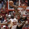 Photo - Iowa State forward Royce White (30) shoots over Oklahoma State forward Michael Cobbins, right, during the second half of an NCAA college basketball game, Wednesday, Jan. 18, 2012, in Ames, Iowa. Iowa State won 71-68. (AP Photo/Charlie Neibergall) ORG XMIT: IACN120