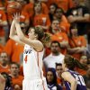OSU\'s Liz Donohoe (4) takes a shot in front of James Madison\'s Kirby Burkholder (20) during the Women\'s NIT championship college basketball game between Oklahoma State University and James Madison at Gallagher-Iba Arena in Stillwater, Okla., Saturday, March 31, 2012. Photo by Nate Billings, The Oklahoman