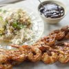Photo -  Maple bourbon barbecue grilled shrimp with couscous.  <strong>Matthew Mead -  AP </strong>