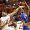 OSU\'s Marshall Moses (23) fouls Marcus Morris (22) of KU in front of OSU\'s James Anderson (23) during the second half during the men\'s college basketball game between the University of Kansas (KU) and Oklahoma State University (OSU) at Gallagher-Iba Arena in Stillwater, Okla., Saturday, Feb. 27, 2010. OSU won, 85-77. Photo by Nate Billings, The Oklahoman
