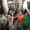 Photo - A survivor goes out of a hospital in Cebu, central Philippines late Friday Aug. 16, 2013. Passenger ferry MV Thomas Aquinas with nearly 700 people aboard sank near the central Philippine port of Cebu on Friday night after colliding with a cargo vessel, and a survivor said he saw bodies in the sea. (AP Photo/Chester Baldicantos)