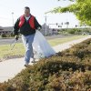 Phil Arnold picks up trash in front of the Bryant Square shopping area during Edmond\'s annual Operation Clean Streets in Edmond, OK, Saturday, April 16, 2011. By Paul Hellstern, The Oklahoman