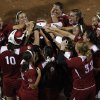 The Sooners welcome Lauren Chamberlain (44) to home base after she hit a home run during Game 3 of the Women\'s College World Series softball championship between OU and Alabama at ASA Hall of Fame Stadium in Oklahoma City, Wednesday, June 6, 2012. Photo by Garett Fisbeck, The Oklahoman