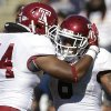 CORRECTS TO SECOND QUARTER, NOT FIRST QUARTER - Temple running back Montel Harris (8) celebrates his touchdown with teammate Wyatt Benson (44) in the second quarter of an NCAA college football game in East Hartford, Conn., Saturday, Oct. 13, 2012. (AP Photo/Michael Dwyer)