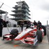 Photo - Former Indy 500 champion Juan Pablo Montoya, of Colombia, sits in his car during testing for the inaugural Grand Prix of Indianapolis auto race on the new road course at Indianapolis Motor Speedway in Indianapolis, Wednesday, April 30, 2014. (AP Photo/Michael Conroy)