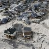 This aerial photo shows the destroyed homes left in the wake of superstorm Sandy on Wednesday, Oct. 31, 2012, in Seaside Heights, N.J. New Jersey got the brunt of Sandy, which made landfall in the state and killed six people. More than 2 million customers were without power as of Wednesday afternoon, down from a peak of 2.7 million. (AP Photo/Mike Groll) ORG XMIT: NJMG110