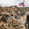Oklahoma City police Sgt. Cody Koelsch walks around the remnants his home at 14701 S Harvey. The May 20 tornado obliterated his home, but Koelsch, his wife and 5-week-old daughter survived by taking cover in a backyard storm shelter. Photo by Jim Beckel, The Oklahoman. Jim Beckel - THE OKLAHOMAN