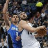 Minnesota Timberwolves\' Nikola Pekovic, right, of Montenegro, eyes the basket as Orlando Magic\'s Nikola Vucevic, also of Montenegro, defends in the first half of an NBA basketball game Wednesday, Nov. 7, 2012, in Minneapolis. (AP Photo/Jim Mone)