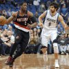 Portland Trail Blazers\' Wesley Matthews (2) moves the ball alongside Minnesota Timberwolves\' Ricky Rubio (9), of Spain, during the fourth quarter of an NBA basketball game Monday, Feb. 4, 2013, in Minneapolis. The Trail Blazers won 100-98. (AP Photo/Hannah Foslien)