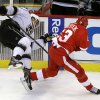 Detroit Red Wings center Pavel Datsyuk (13), of Russia, checks Los Angeles Kings center Dwight King during the third period of an NHL hockey game in Detroit, Wednesday, April 24, 2013. (AP Photo/Carlos Osorio)