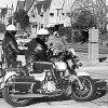 Two Oklahoma City police officers watch for speeders on N Robinson near NW 32 in this 1981 photo. DAVID McDANIEL - The Oklahoman archives