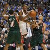 Desmond Mason (34) of the Thunder drives against the Bucks\' Malik Allen (30) and Richard Jefferson (24) during the opening NBA basketball game between the Oklahoma City Thunder and the Milwaukee Bucks at the Ford Center in Oklahoma City, Wednesday, October 29, 2008. BY BRYAN TERRY, THE OKLAHOMAN