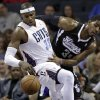 Charlotte Bobcats\' Brendan Haywood (33) and Sacramento Kings\' Jason Thompson (34) battle for a rebound during the first half of an NBA basketball game in Charlotte, N.C., Saturday, Jan. 19, 2013. (AP Photo/Chuck Burton)