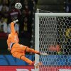 Photo - Algeria's goalkeeper Rais M'Bolhi makes a diving save during the World Cup round of 16 soccer match between Germany and Algeria at the Estadio Beira-Rio in Porto Alegre, Brazil, Monday, June 30, 2014. (AP Photo/Matthias Schrader)