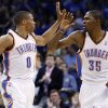 Photo -   Oklahoma City Thunder guard Russell Westbrook (0) and forward Kevin Durant (35) exchange high-fives following a basket by Westbrook in the second quarter of an NBA basketball game against the Chicago Bulls in Oklahoma City, Sunday, April 1, 2012. (AP Photo/Sue Ogrocki)