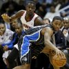 Orlando Magic\'s Moe Harkless, right, dribbles the ball away from Atlanta Hawks\' Anthony Morrow in the first quarter of an NBA basketball game, Monday, Nov. 19, 2012, in Atlanta. (AP Photo/David Goldman)