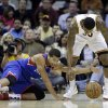Photo - Philadelphia 76ers' Michael Carter-Williams, left, and Cleveland Cavaliers' Alonzo Gee reach for a loose ball during the first quarter of an NBA basketball game Saturday, Nov. 9, 2013, in Cleveland. (AP Photo/Tony Dejak)