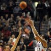 Photo - Portland Trail Blazers forward LaMarcus Aldridge (12) shoots the ball over Golden State Warriors forward David Lee (10) during the first half of an NBA basketball game in Portland, Ore., Sunday, April 13, 2014. (AP Photo/Steve Dykes)