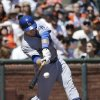 Photo - Los Angeles Dodgers' Tim Federowicz hits an RBI single off San Francisco Giants pitcher Madison Bumgarner during the second inning of a baseball game in San Francisco, Thursday, April 17, 2014. (AP Photo/Jeff Chiu)