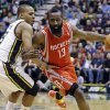 Houston Rockets\' James Harden (13) drives around Utah Jazz\'s Randy Foye (8) during the second quarter of an NBA basketball game, Monday, Jan. 28, 2013, in Salt Lake City. (AP Photo/Rick Bowmer)