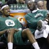 FILE - Boston Celtics center Kevin Garnett, right, chats with teammate Paul Pierce on the bench during the fourth quarter of an NBA basketball game against the Toronto Raptors in Boston, in this March 13, 2013 file photo. The Brooklyn Nets will acquire Paul Pierce and Kevin Garnett from the Boston Celtics in a deal that was still developing as the NBA draft ended, according to a person with knowledge of the details. The trade can\'t be completed until July 10, after next season\'s salary cap is set, so pieces were still being discussed early Friday June 28, 2013. (AP Photo/Elise Amendola, File) ORG XMIT: NY113